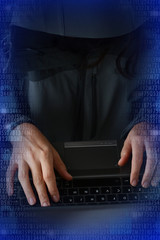 Hacker attack concept with programmer stealing passwords at notebook