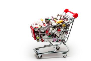 Poster shopping cart full of pills isolated on white