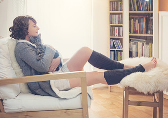 woman hugging with kitty in cosy living room