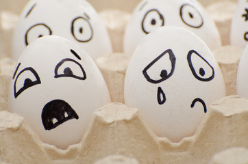 Eggs with the drawn emotions, frightened and crying face