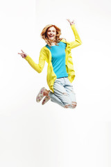 young pretty teenage girl jumping cheerful isolated on white background, lifestyle people concept
