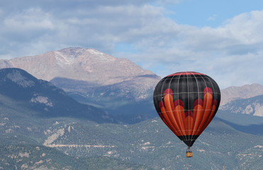 Colorful hot Air Balloon flying over Pikes Peak, Colorado Spring