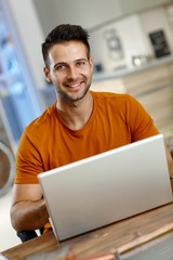 Handsome young man using laptop