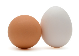 Two white and brown eggs isolated on white background