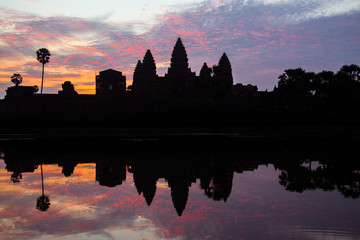 The silhouette of Angkor Wat the largest religious temple in the world before the sunrise in Siem Reap, Cambodia.