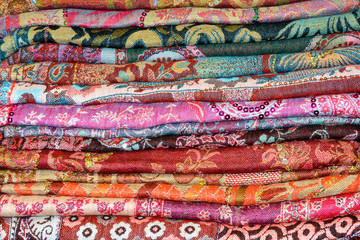 Colored Indian shawls cashmere background