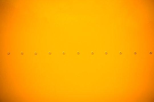 yellow metal sheet with dark vignette free copy space for text,
