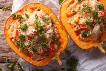 Baked pumpkin stuffed with couscous, meat and vegetables close-up. horizontal top view