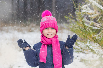 girl rejoices first snow. It is snowing heavily. Snow in October. the long-awaited snow.