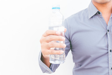 Man with water from bottle on white background