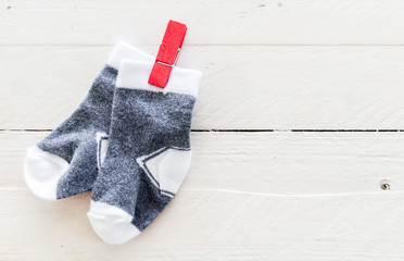 Baby socks on a wooden background  with copy space