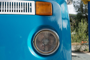 Closeup of vintage car headlight, front view