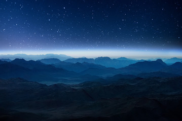 Papiers peints Bleu nuit Night mountains before sunrise in the Egypt. Sinai Peninsula, the mountain of Moses