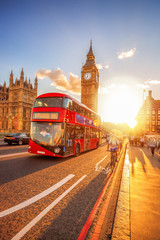 Foto auf Leinwand London roten bus Big Ben against colorful sunset in London, UK