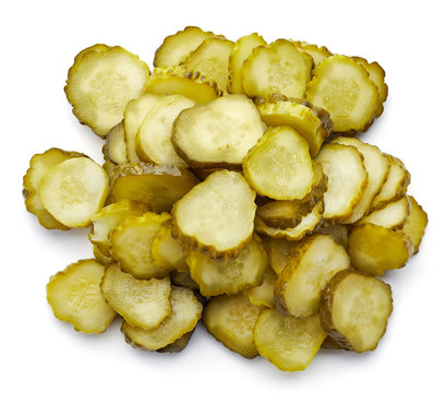 Heap of pickled cucumber slices from above