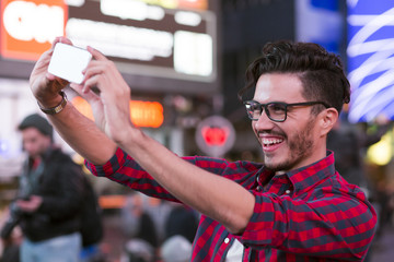 Man taking a selfie on Times Square