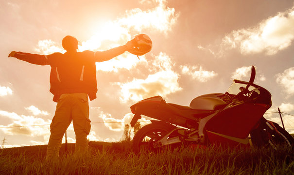 Silhouette of a sport motorbike and biker.