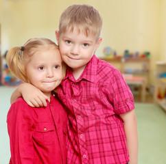 Little boy and girl hugging