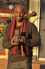 Photographer Holding Vintage Camera