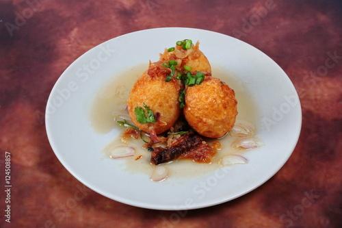 """Fried hard-boiled eggs with tamarind sauce call as Khai ..."