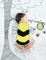 illustration draw on adorable baby girl is bee flying for honey.