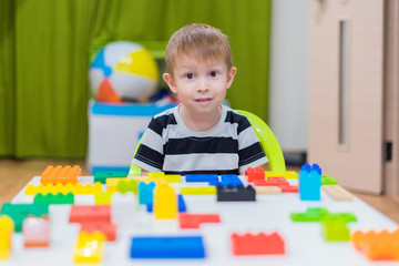 Boy plays in the constructor