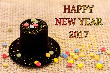 ein Zylinder liegt auf Stoff für Neujahr 2017