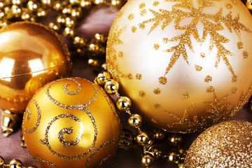 Festive gold Christmas decorations on fabric background
