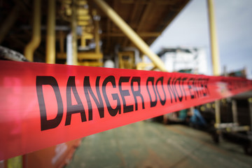 Dark tone of red danger tape  barricade in plant industry  preve Wall mural