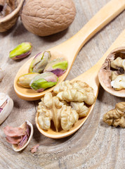 Closeup of a walnut and pistachios.