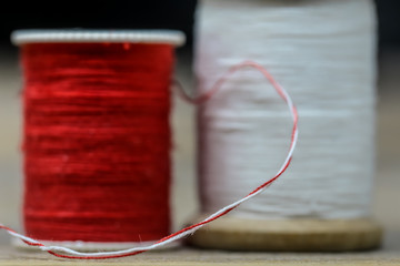 Sewing thread white and red colors