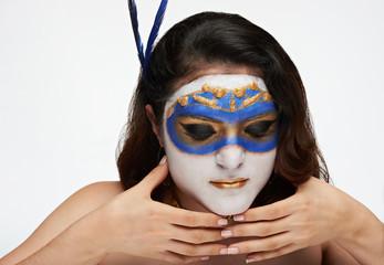 women hold mask