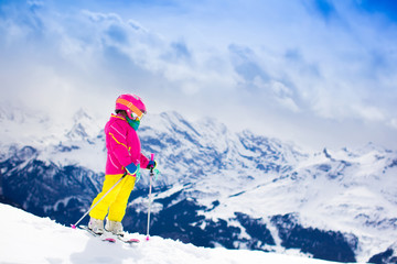 Little child skiing in the mountains