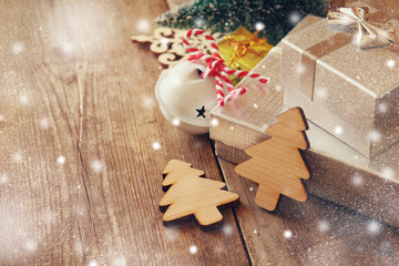 Decorative wooden christmas tree next to gift boxes