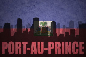 abstract silhouette of the city with text Port-au-Prince at the vintage haitian flag