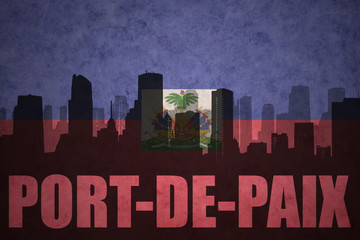 abstract silhouette of the city with text Port-de-Paix at the vintage haitian flag