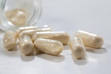 Closeup of transparent  Probiotics  capsule in glass bottle