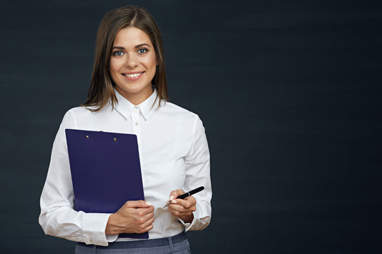 Smiling business woman holding clipboard with pen.