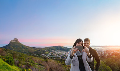 Tourist couple taking a selfie in Cape Town