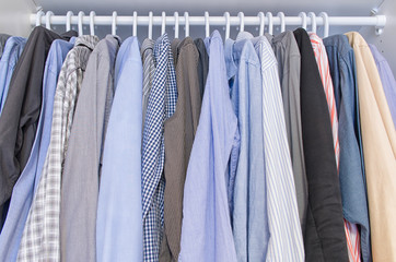 Men shirts hang on a clothes hanger