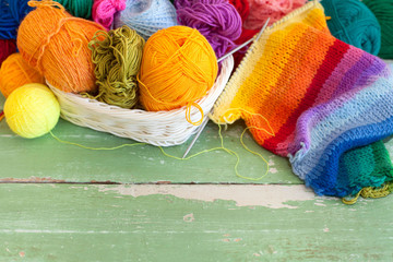 Coloured wool yarn into skeins and tangles.
