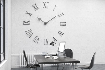Side view of office with large wall clock