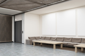 Waiting area with sofas, coffee tables and elevator