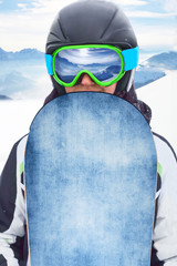 Close up Portrait of snowboarder in Carpathian Mountains, Bukovel Snowboarder. A mountain range reflected in the ski mask