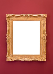 Empty golden picture frame on the wall