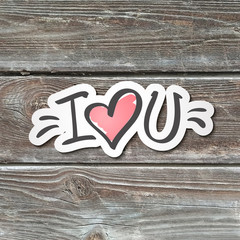 i love you, handwritten text, paper sticker on realistic wood texture