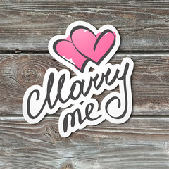 marry me, handwritten text, paper sticker on realistic wood texture
