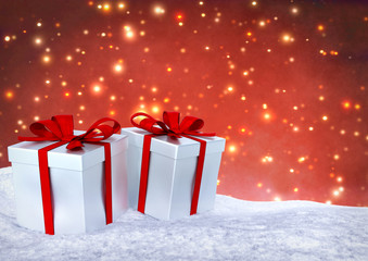Christmas gifts in snow on bokeh red background. 3D render.