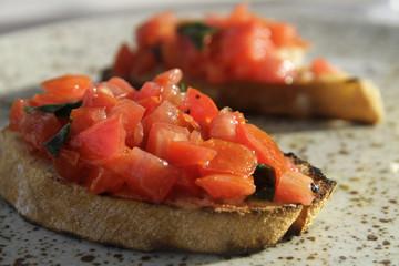 Italian starter bruschettas with tomatoes