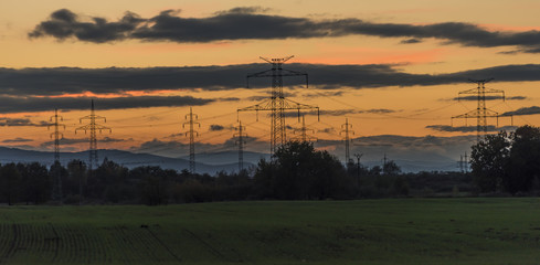 Electric poles after autumn sunset